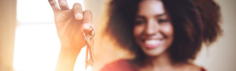 a first time buyer holds the keys to her new house